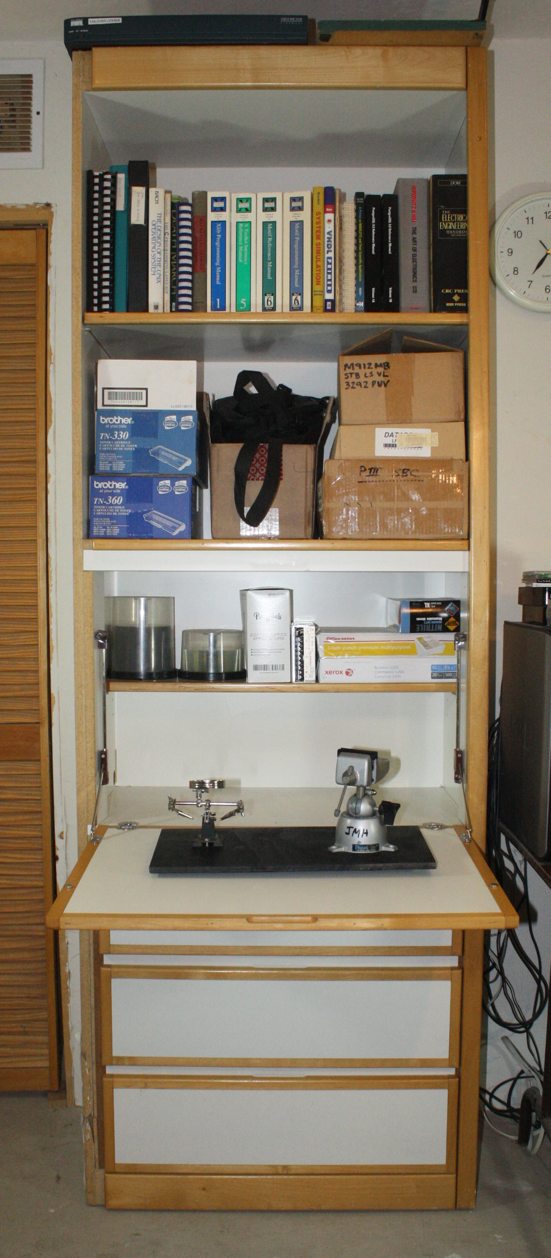 19 Tools You Need To Start Working With Electronics Oreilly Media Man Hand Holding A Magnifying Glass Above Circuit Board Combination Cabinet And Shelf Unit Fold Down Table Opened